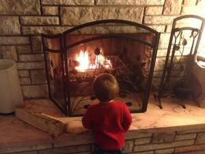 My son mesmorized by our fireplace